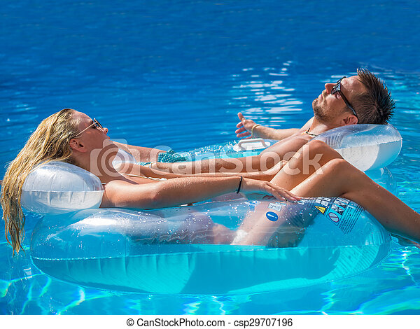 Couple Outside Relaxing In Swimming Pool - csp29707196