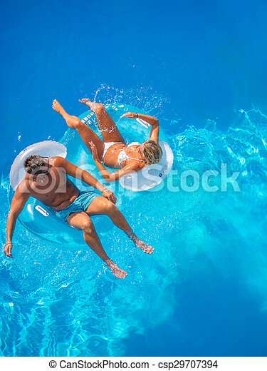 Couple Outside Relaxing In Swimming Pool - csp29707394