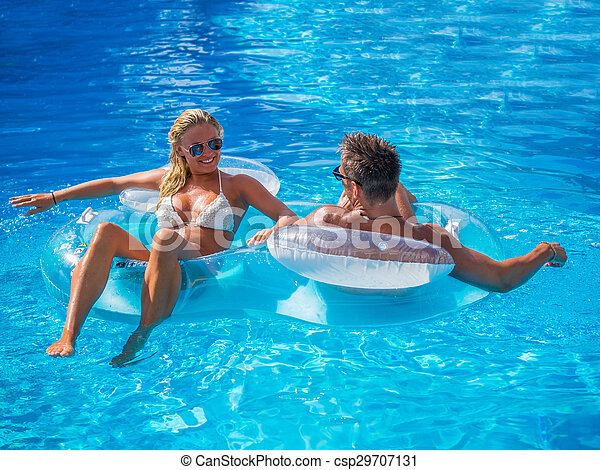Couple Outside Relaxing In Swimming Pool - csp29707131