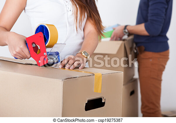 Couple Packing Cardboard Boxes - csp19275387