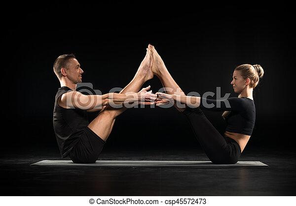 Couple performing acroyoga - csp45572473