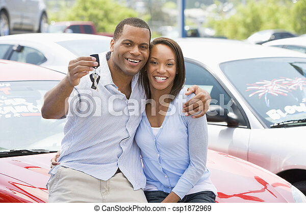 Couple picking up new car - csp1872969