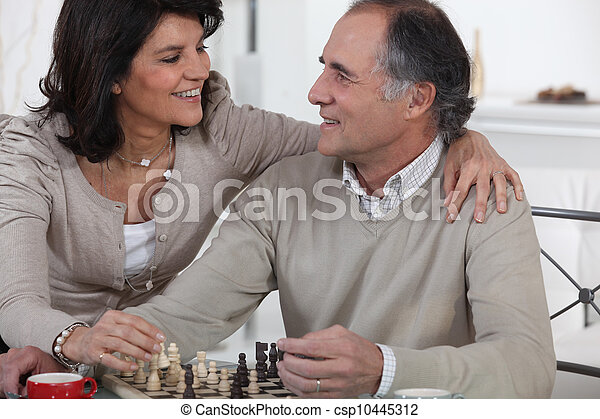 Couple playing chess - csp10445312