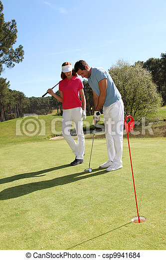 Couple playing golf on a sunny day - csp9941684