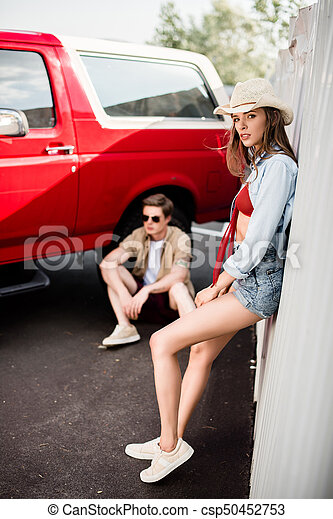couple posing next to vintage car - csp50452753