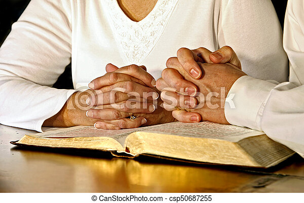 Couple Praying with Holy Bible - csp50687255