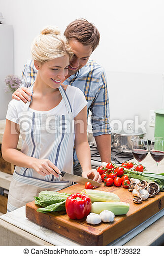 Couple preparing food together in the kitchen - csp18739322