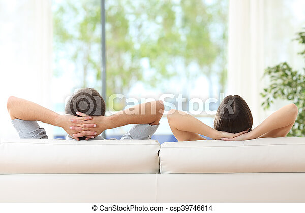 Couple relaxing on a couch at home - csp39746614