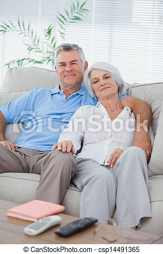 Couple relaxing on a couch - csp14491365