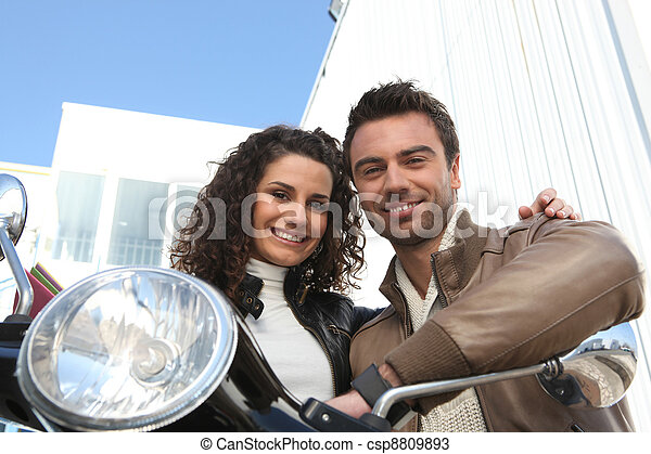 Couple sat on scooter - csp8809893