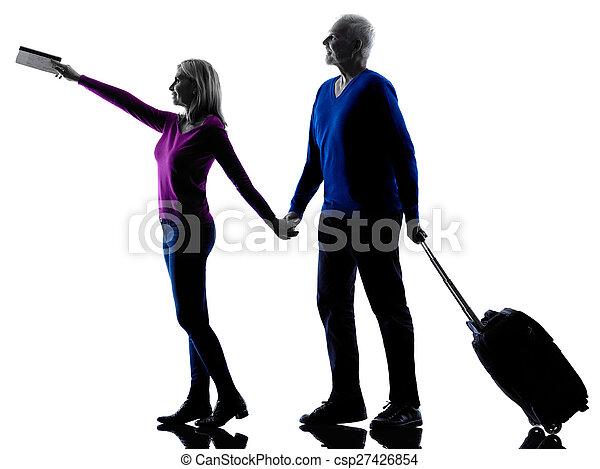 couple senior travelers traveling silhouette - csp27426854
