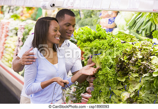 Couple shopping in produce department - csp1890093