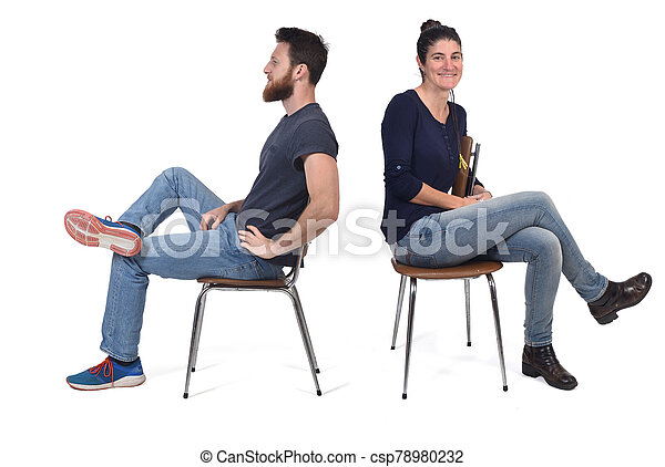 couple sitting in a vintage chair isolated on white - csp78980232