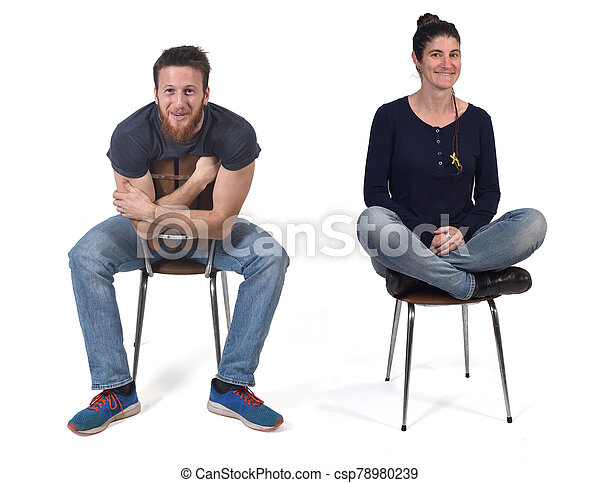 couple sitting in a vintage chair isolated on white - csp78980239