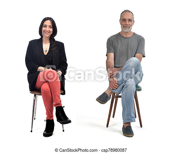couple sitting on a vintage chair isolated on white - csp78980087