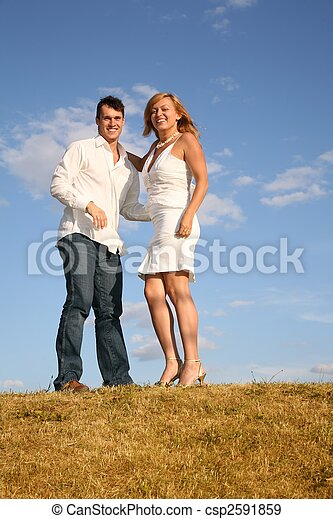 couple stand on meadow - csp2591859