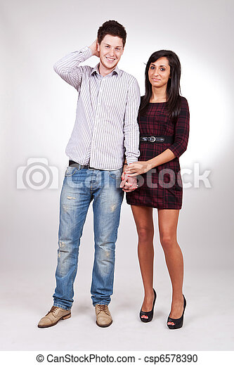 picture of a young couple standing next to each other holding hands