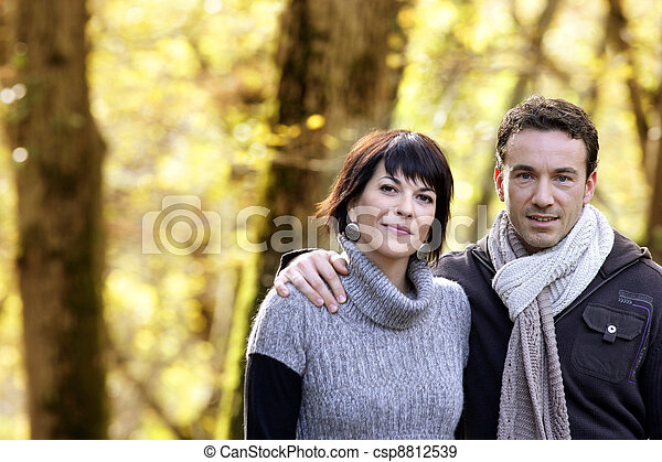 Couple strolling in the park together - csp8812539