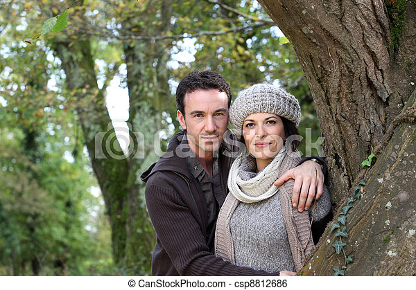 Couple strolling in the woods together - csp8812686