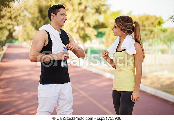 Couple taking a break from running - csp31755906