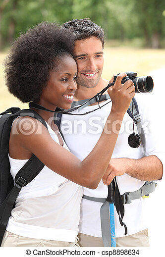 Couple taking pictures - csp8898634