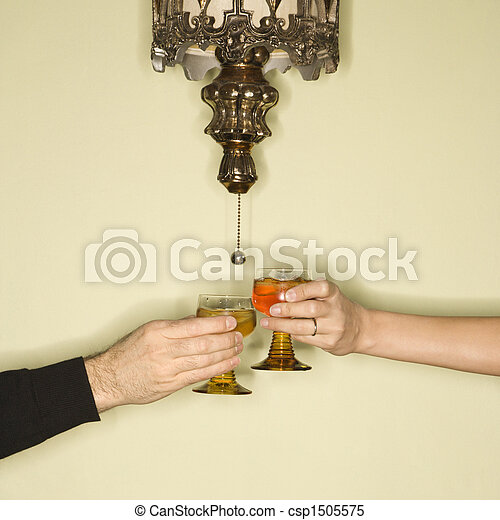 Couple toasting drinks. - csp1505575