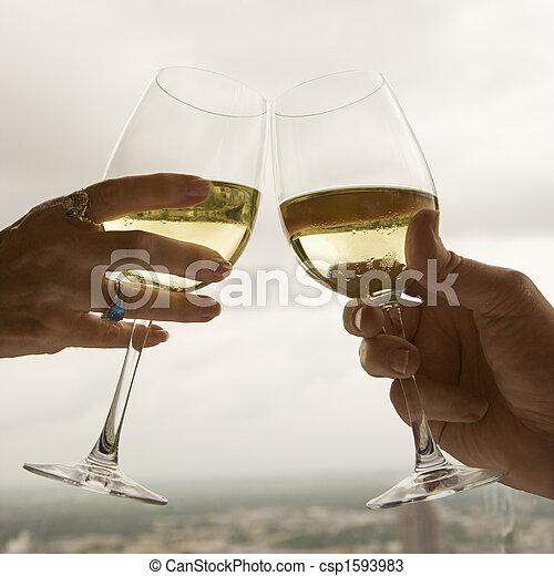 Couple toasting. - csp1593983