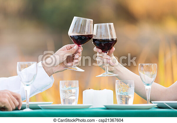 couple toasting with red wine - csp21367604