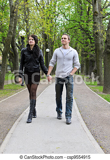 Couple walking down the road in the park. - csp9554915