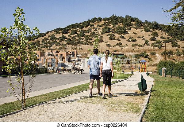 Couple walking in suburban development - csp0226404