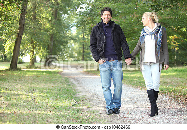 Couple walking in the park - csp10482469
