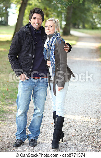 Couple walking in the park - csp8771574