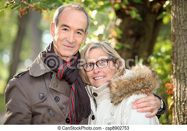Couple walking in the woods - csp8902753