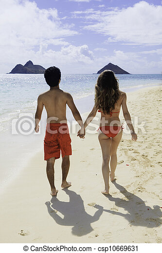 couple walking on a hawaii beach - csp10669631