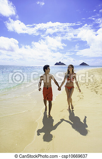 couple walking on a hawaii beach - csp10669637