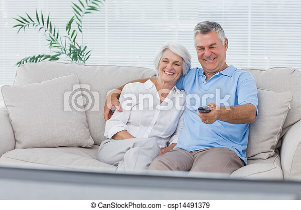 Couple watching television sitting on the couch - csp14491379
