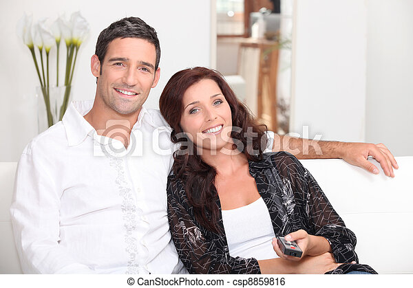 couple watching television - csp8859816