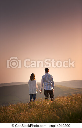 couple watching the sunset - csp14949200
