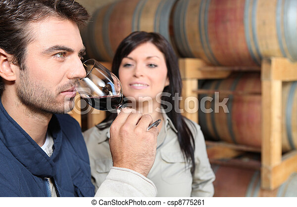 Couple wine tasting in a cellar - csp8775261
