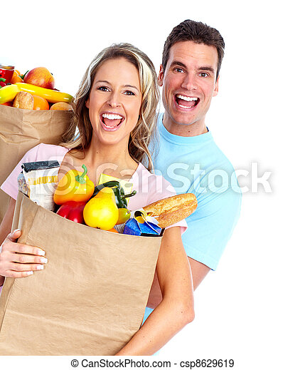 Couple with a grocery bag. - csp8629619