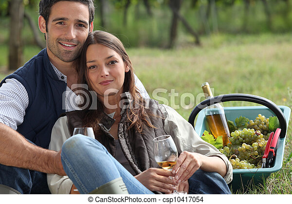 Couple with basket of grapes and wine - csp10417054