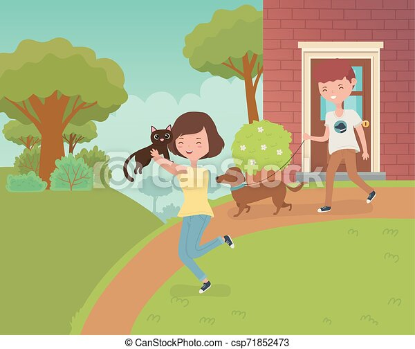 couple with cute little cat and dog in the house garden - csp71852473
