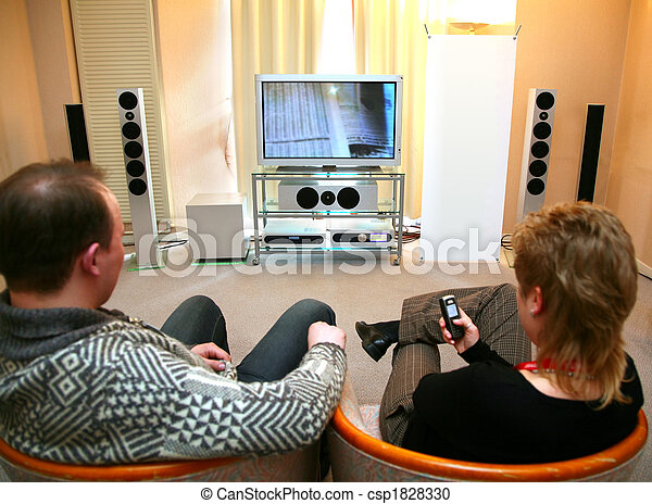 couple with home theater - csp1828330