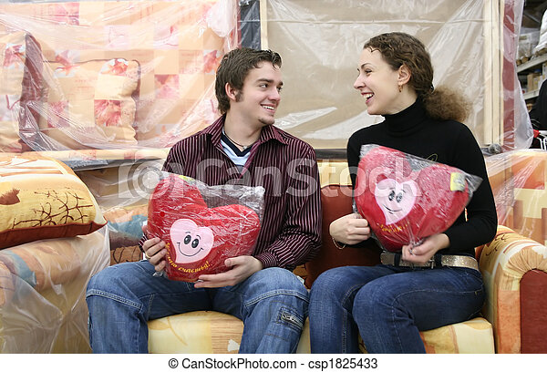 couple with love hearts in furniture shop - csp1825433