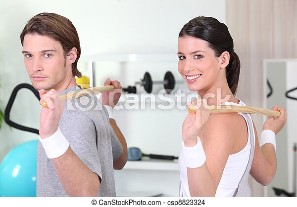 Couple working out together - csp8823324