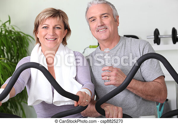 Couple working out together - csp8825270