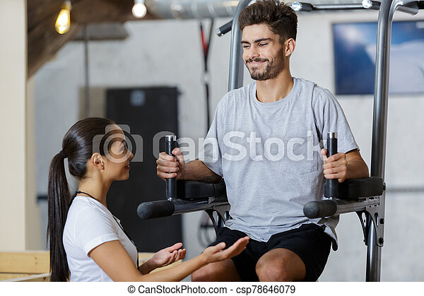couples are exercising in the gym - csp78646079