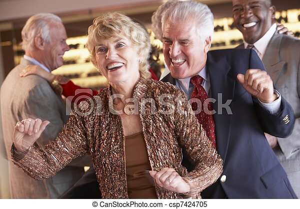 Couples Dancing Together At A Nightclub - csp7424705