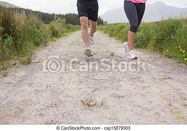 Couples feet running on a trail - csp15879303