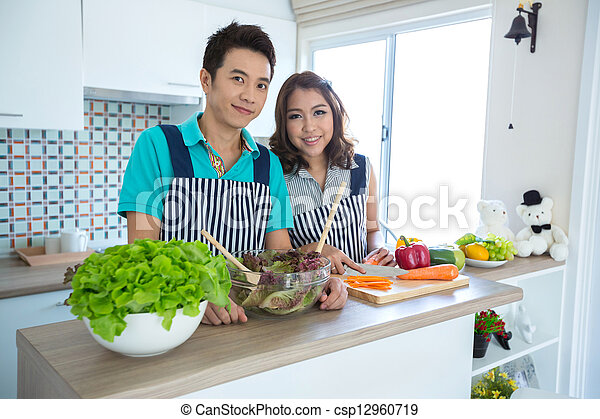 Couples in kitchen - csp12960719